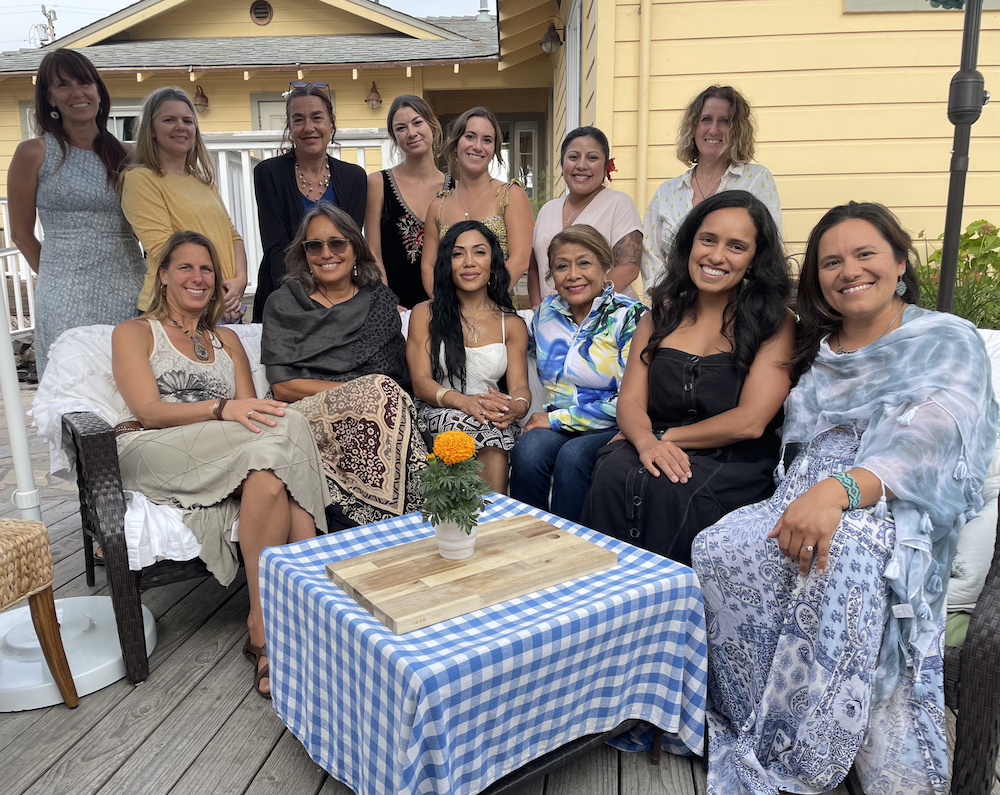 A group of women gathering for a Women Who Are Up To Something event.